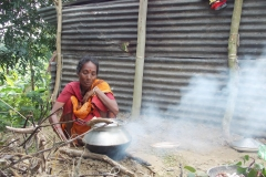 A adivasi woman trying to cook food with wetted firewood001