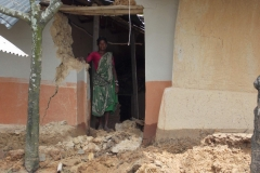 An adivasi woman was stading on from her damaged house002